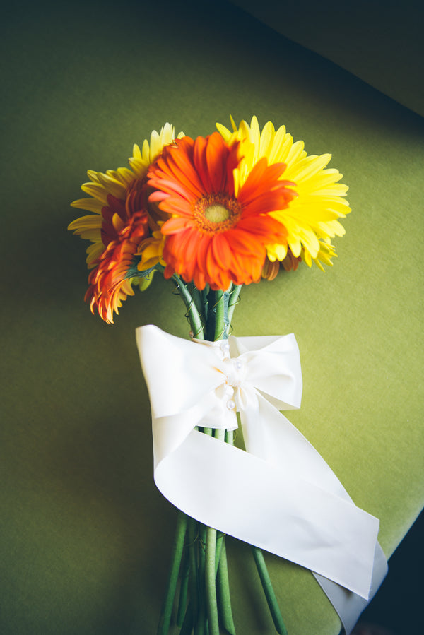 Modern and Whimsical Wedding | Mint, Orange, and Lemon Color Palette| Gerber Daisy Bouquet | Orange and Yellow Bouquet | Buffalo Wedding | Christina Laing Photography | Kate Aspen Blog