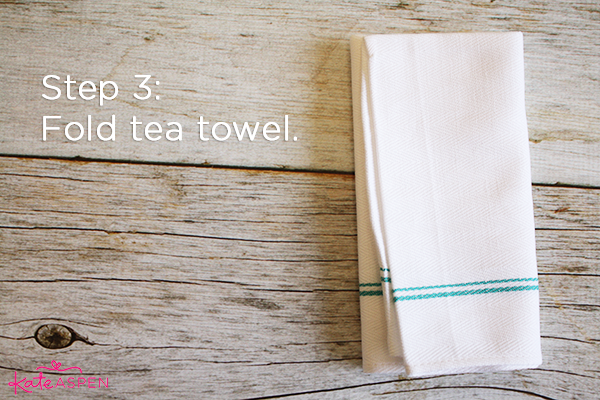 Step 3 Fold Tea Towel | DIY Kitchen Bridal Shower Whisk and Towel Favors | Kate Aspen