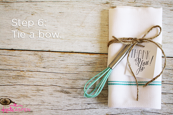 Step 6 Tie a Bow | DIY Kitchen Bridal Shower Whisk and Towel Favors | Kate Aspen