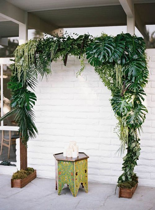 A Simple Tropical Palm Wedding Ceremony Backdrop | Ashley Keleman Photography via Brides