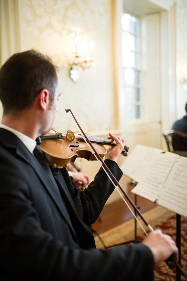 Violin Player at Ceremony | Peachy Pink Wedding in Historic Charleston | Priscilla Thomas Photography