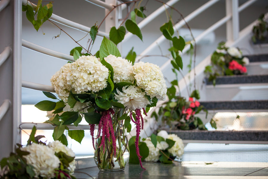 White and Pink Floral Arrangements | Aviation Themed Wedding | Red Bridge Photography