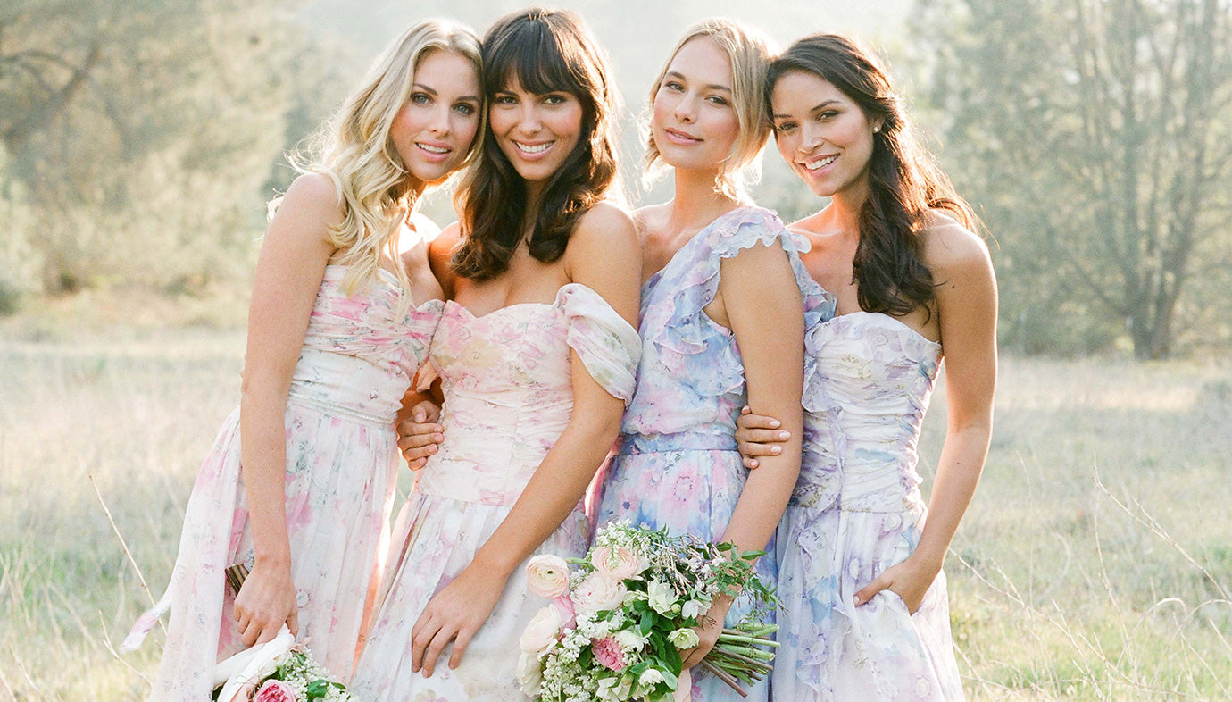 Bridesmaids in Pastel Floral Watercolor Bridesmaid Dresses | Plum Pretty Sugar Couture