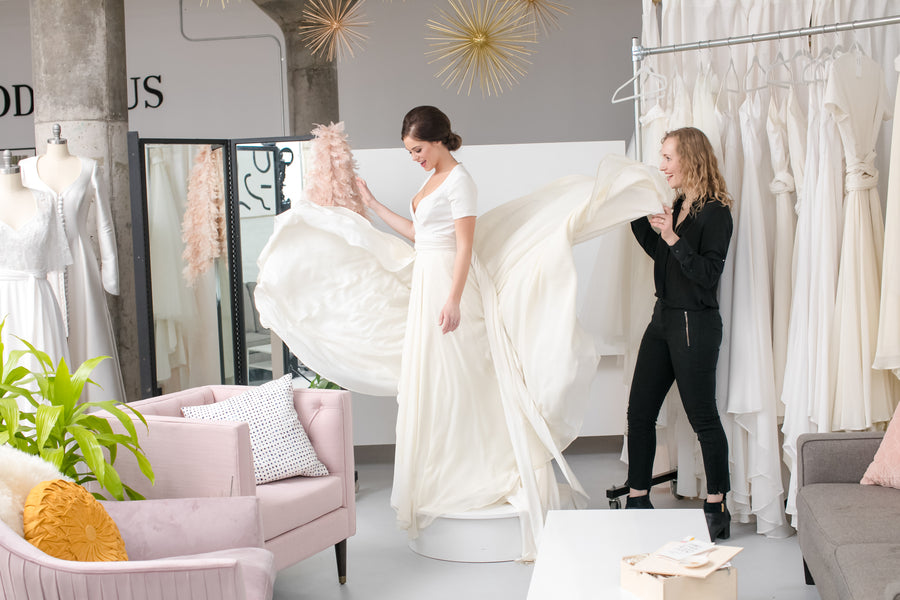 Bride Putting On Wedding Dress | Fun Tips For Getting Ready On Your Wedding Day | Kate Aspen