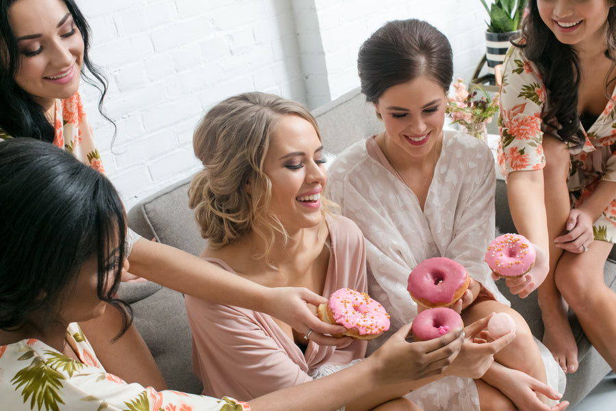 Bridal Party Eating Doughnuts | Fun Tips For Getting Ready On Your Wedding Day | Kate Aspen