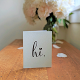 "Mint Green ""hi."" card with white flowers"