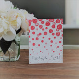 Sprinkle of Flowers thank you card on table