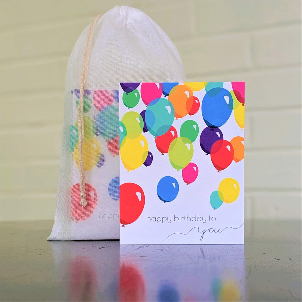 Balloons Birthday Card, single card in front of set in sheer cotton pouch