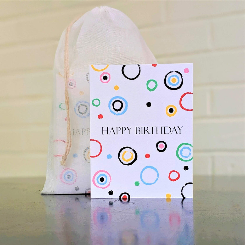 Circles Happy Birthday Card, single card in front of set in sheer cotton pouch