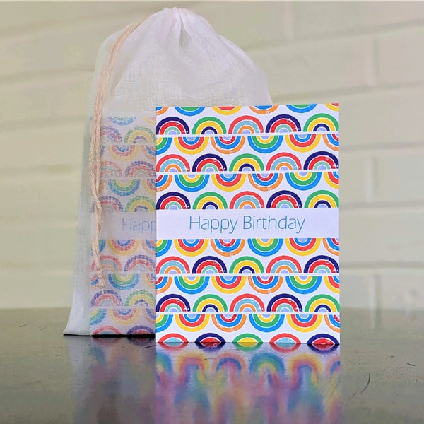 Rainbows Birthday Card, single card in front of set in sheer cotton pouch