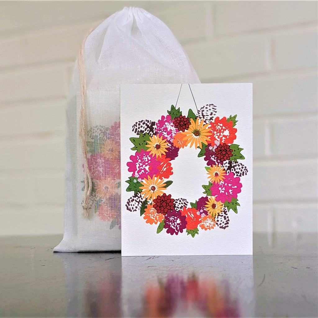 Fall Floral Wreath greeting card, single card in front of set in sheer cotton pouch
