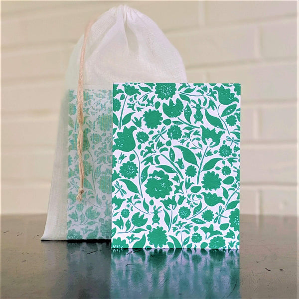 Botanical Collage greeting card in green, single card in front of set in sheer cotton pouch