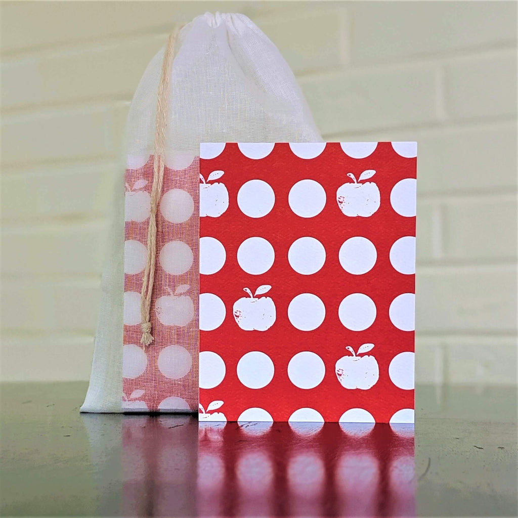 Apple Dots greeting card, single card in front of set in sheer cotton pouch