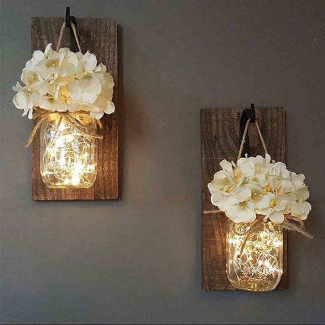 Mason jar and flower fairy light sconce