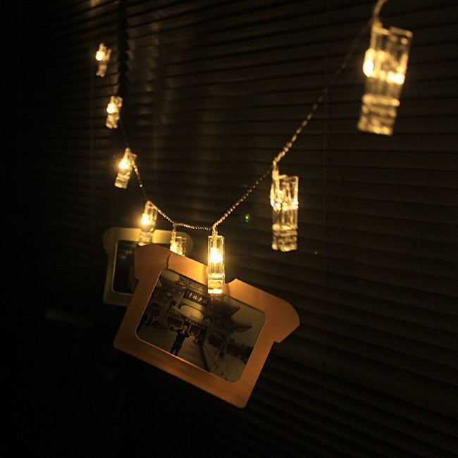 Cozy home decoration led fairy lights. Warm white photo clips fairy lights.