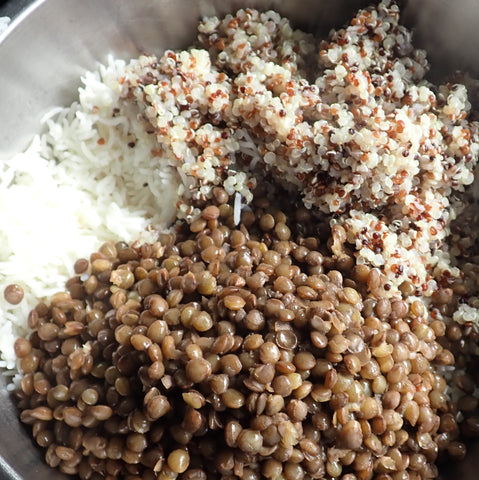 Blend grains and lentil to form base of salad