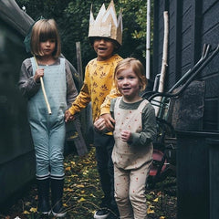3 kids wearing cub and pudding dungarees