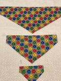 Paws Dog bandanas. Grey with multi coloured paws. Small, medium, large, fits ON the collar!