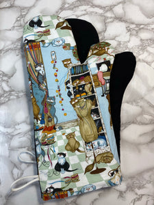 Oven mitts. Animals. Cats in the sewing room!