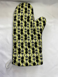 Oven mitts, black cat on green background. A pair of fully functional oven gloves!