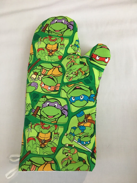 Oven mitts. Pop culture. Teenage Mutant Ninja Turtles!