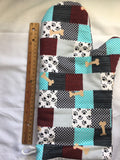 Oven mitts, dog bones and plaid. A pair of fully functional long oven gloves.
