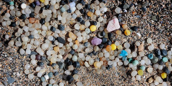 Beach covered in multi-coloured nurdles