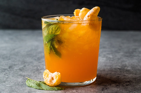 Clementine Mojito Cocktail with Mint Leaves and Ice