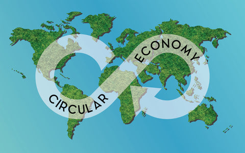A map of the earth with a circular economy symbol
