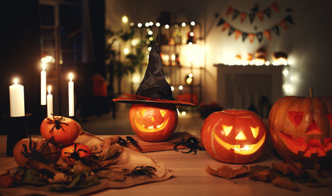 Halloween decorated house: pumpkins on the table and spooky lights