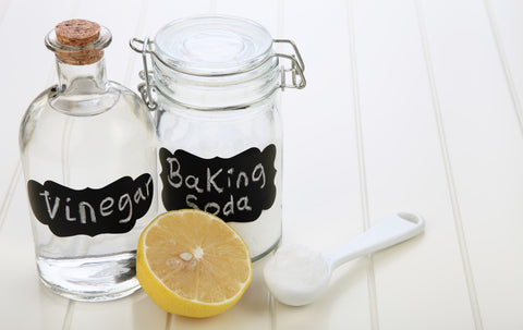 Vinegar, baking soda and lemon cleaning products