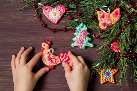 A hand holding handcrafted salt dough ornaments