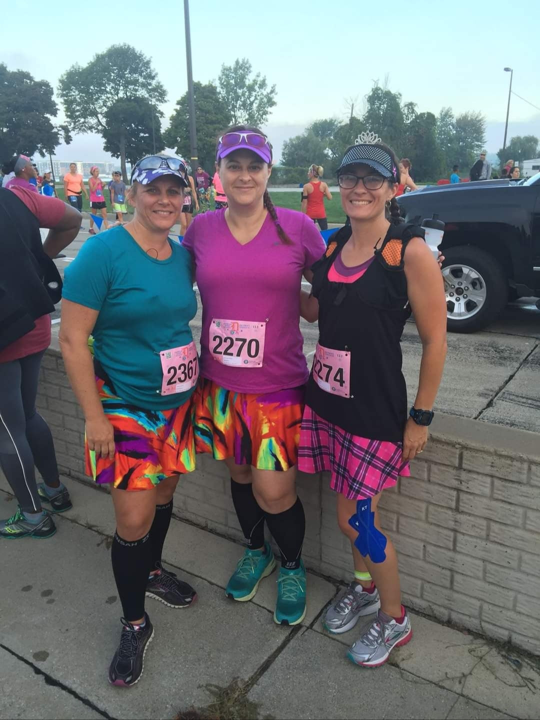 Melissa Marowelli posing at a race with friends wearing Bolder Athletic Wear skirts