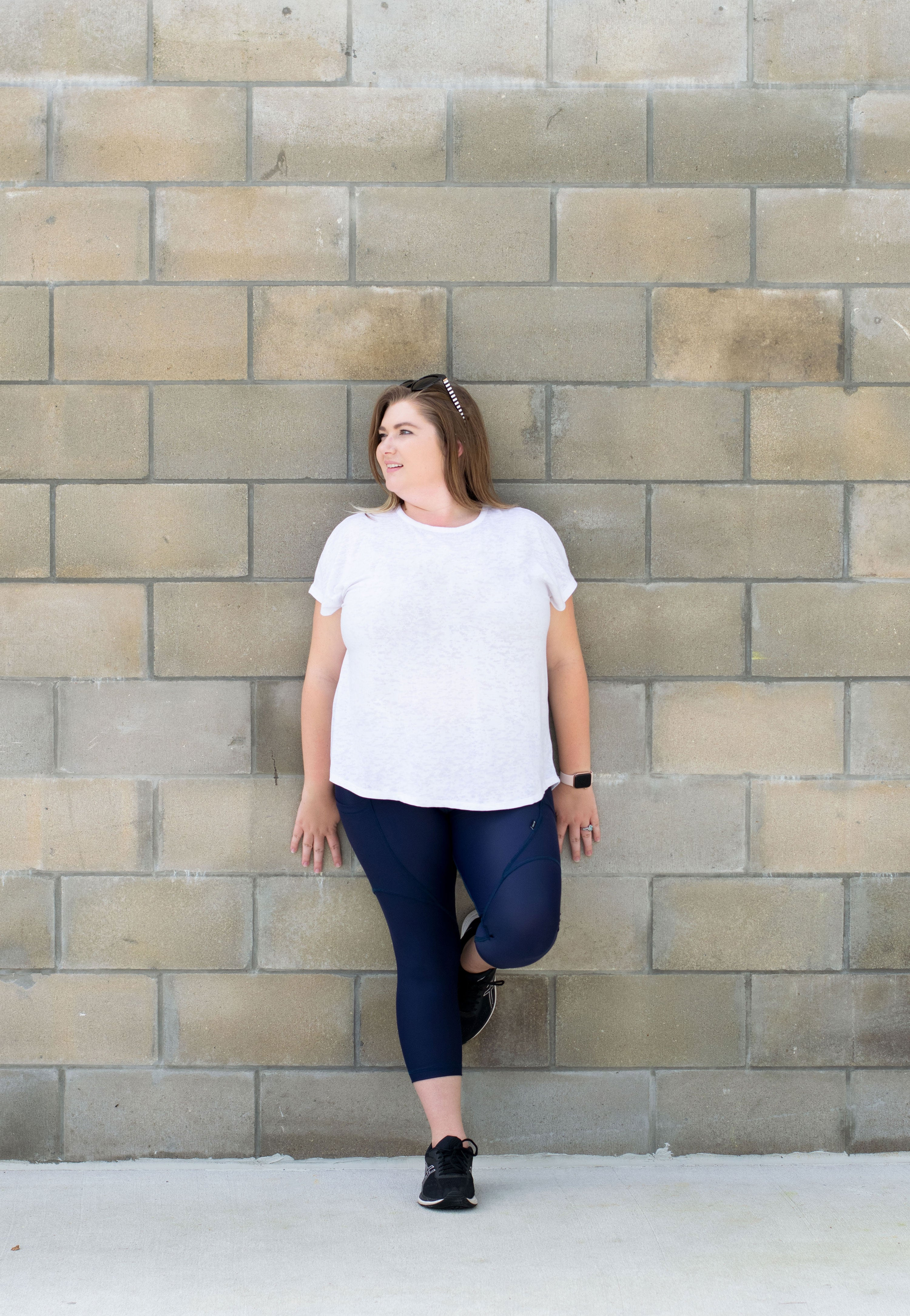 Navy leggings with model leaning against wall