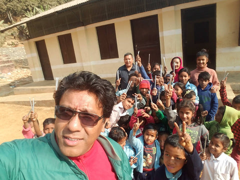 Raj from Adventure Thirdpole delivering our pencils to the kids in Nepal