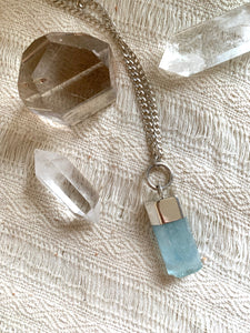 Aquamarine crystal talisman with sterling silver O ring attachment and curb chain with quartz crystal and smoky quartz tower.
