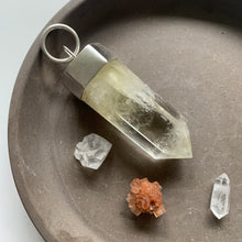Load image into Gallery viewer, Large pale citrine crystal talisman on gray dish with quartz crystals and aragonite.