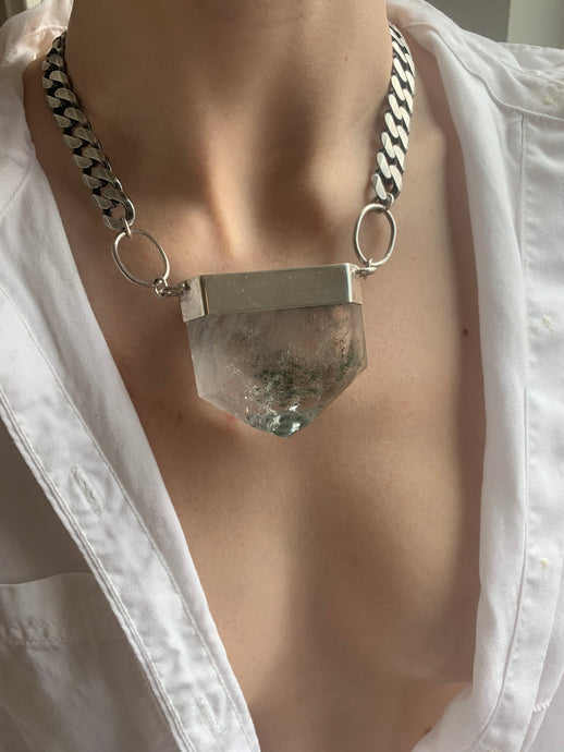 Large Chlorite quartz talisman necklace with large sterling silver curb chain on girl with open button down white shirt.