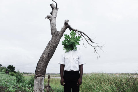 Nana Yaw Oduro picture of a boy behind a tree