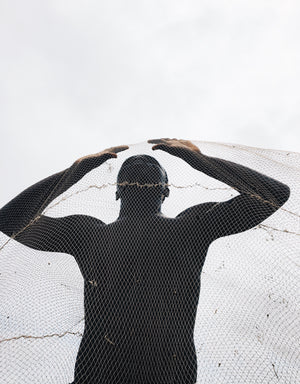 Gasp a picture showing a man trapped in a net by Nana Yaw Oduro.