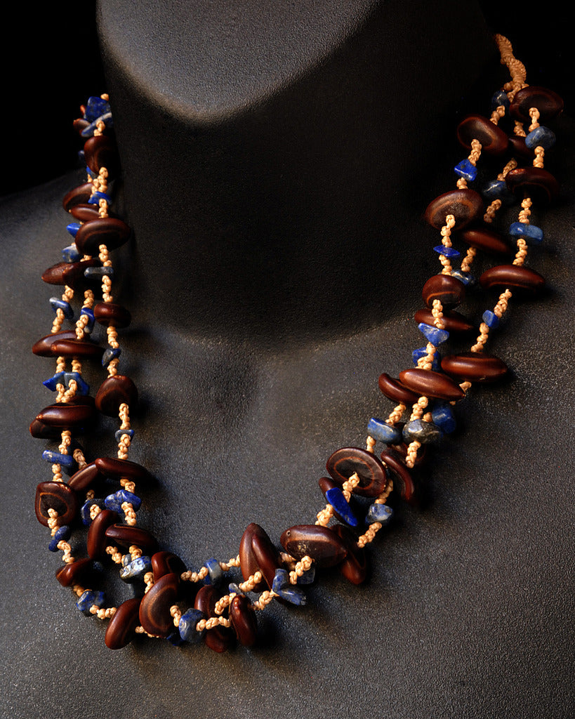 Handmade seed and lapis lazuli necklace side
