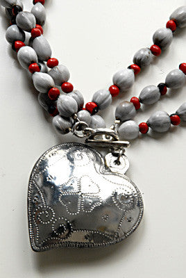 Handmade tin heart necklace detail with