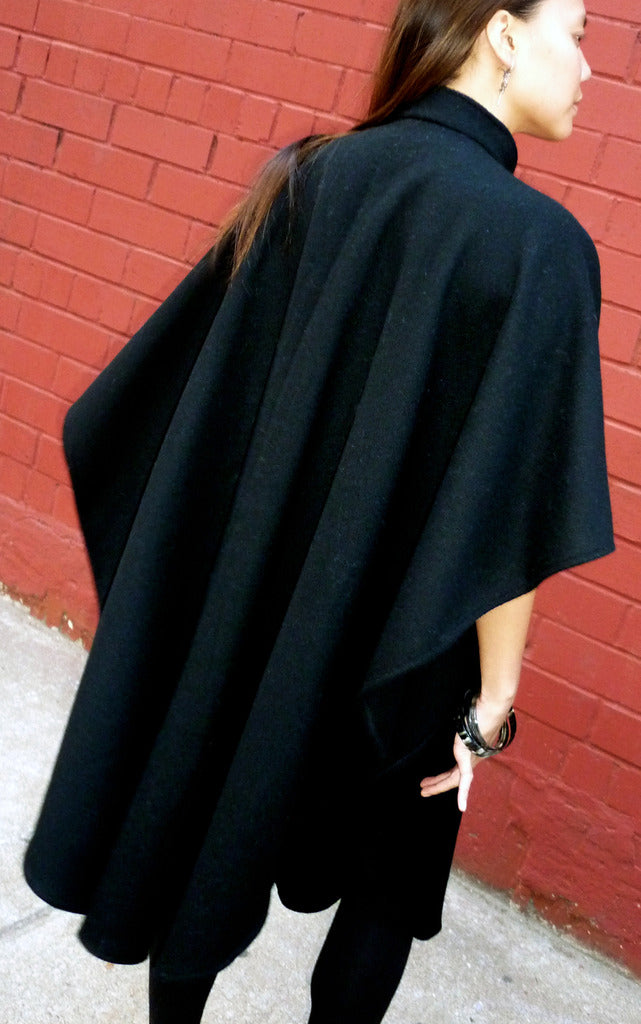 Authentic rounded wool poncho with mandarin collar back