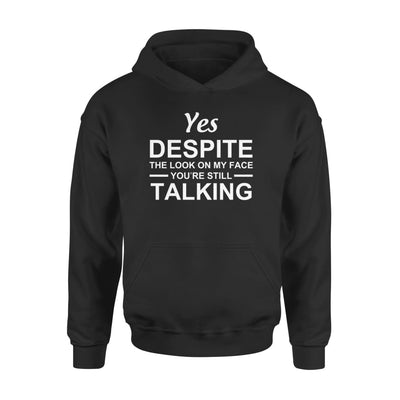 Yet despite the look on my face youre still talking - Standard Hoodie - S / Black