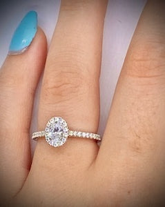 Oval Cut 0.55 CTW Diamond Halo Engagement Ring D-E/VS Grade