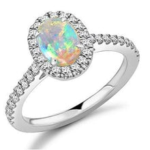 Load image into Gallery viewer, 950 Platinum Oval Opal & Diamond Halo Ring 0.85 CTW - Pobjoy Diamonds