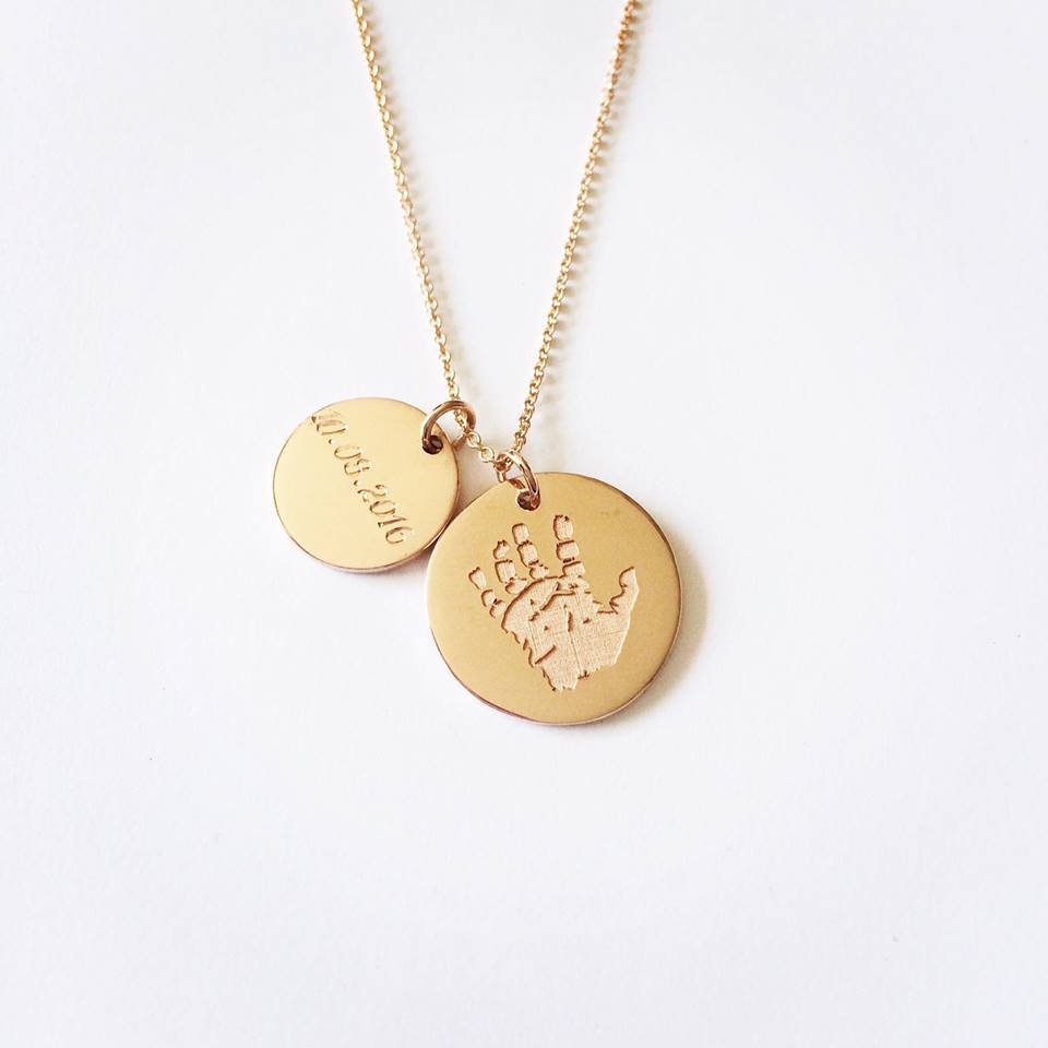 A beautiful handcrafted 9ct gold disc custom engraved with the hand or footprints of your little ones.