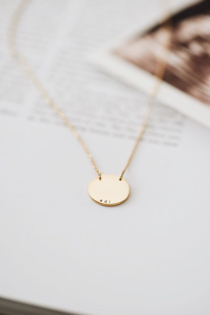 Our Carter pendant is a classic disc necklace that is created in solid 9ct gold and measures 14mm in diameter. Your disc is custom engraved with the names of your loved ones.