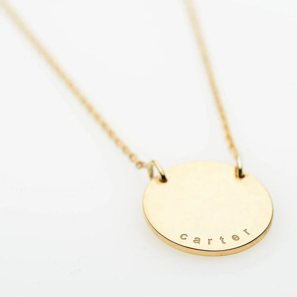 Our Carter pendant is a 9ct solid gold disc which is custom engraved with the names of your children. Each personalized pendant we create is completely unique to you and your family.