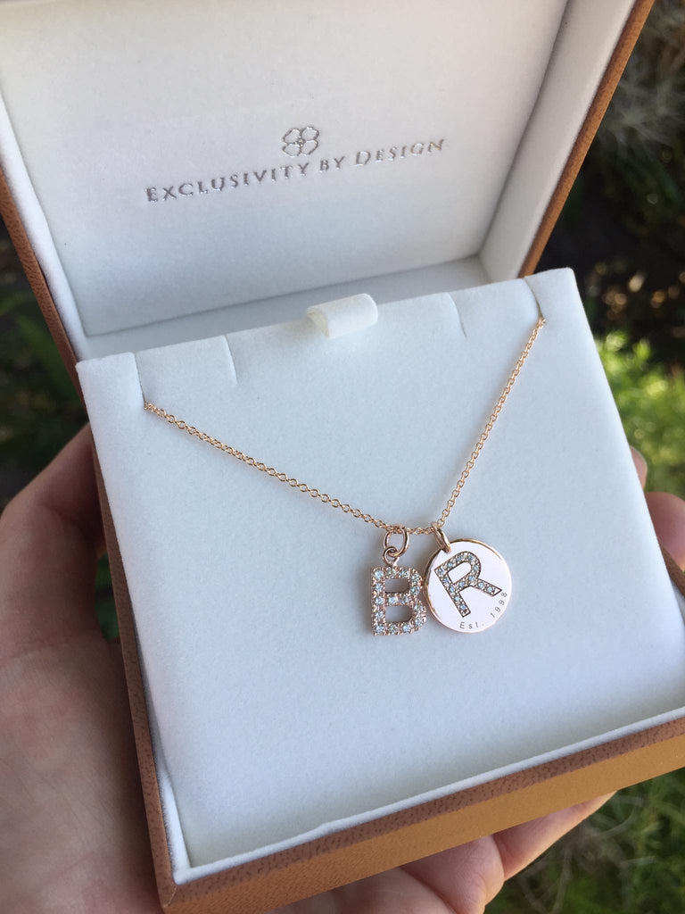 9ct Gold and Diamond Letter Necklace. The diamond initial charm is created with round brilliant diamonds and the 9ct gold custom engraved disc is personalized with the name, initial or date that is special to you.